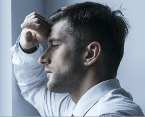 Stressed Man Staring Out Of Window1